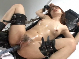 Woman upside down in bondage and used with toys