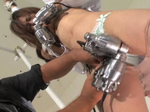 Slender woman bound with rope and used by toys