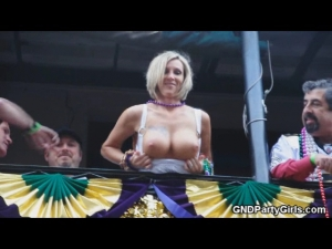 Sexy blonde shows off her tits